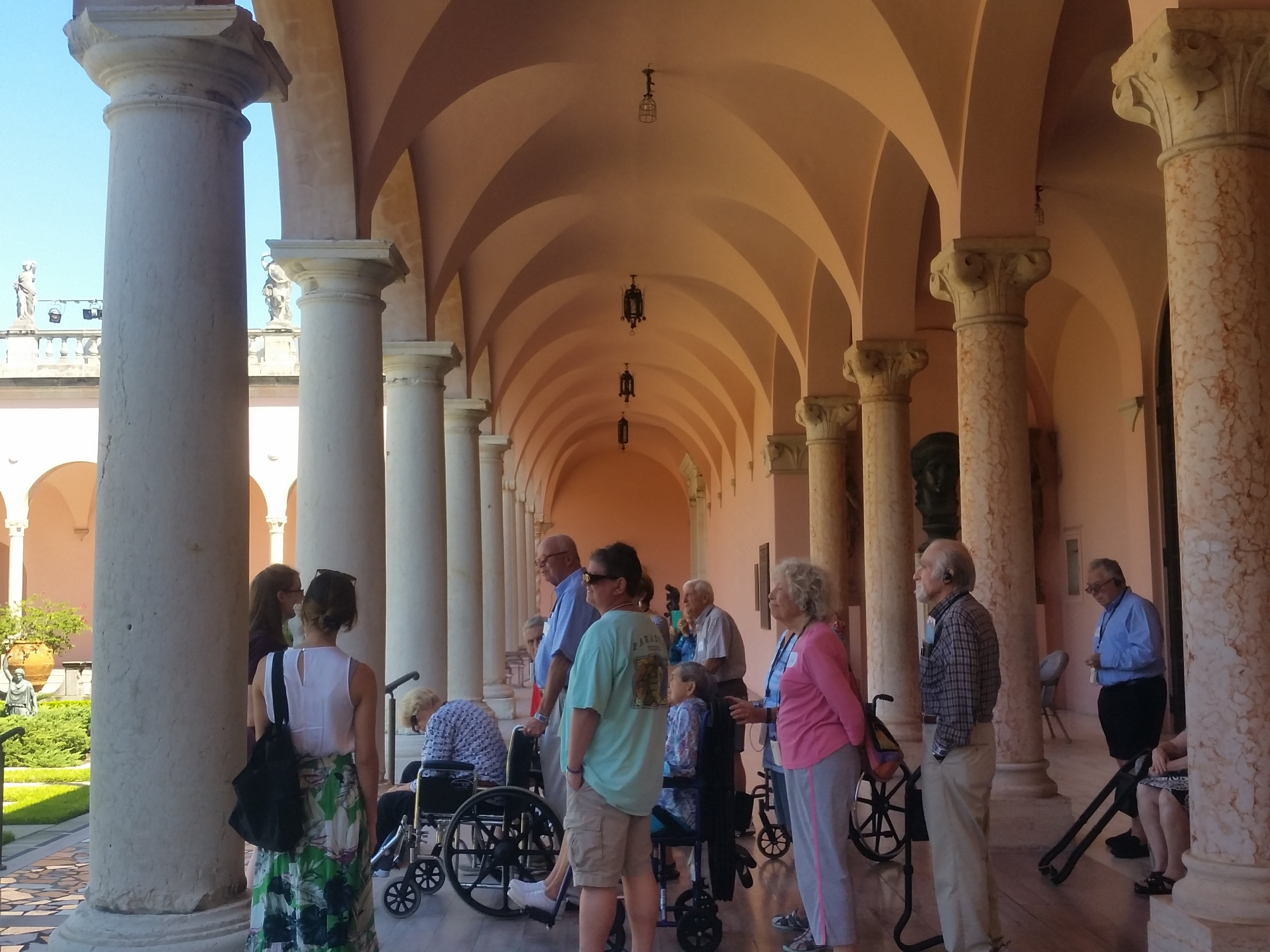 Tour Group in the Museum of Art Courtyard at The Ringling, Some people using wheelchairs and listening devices