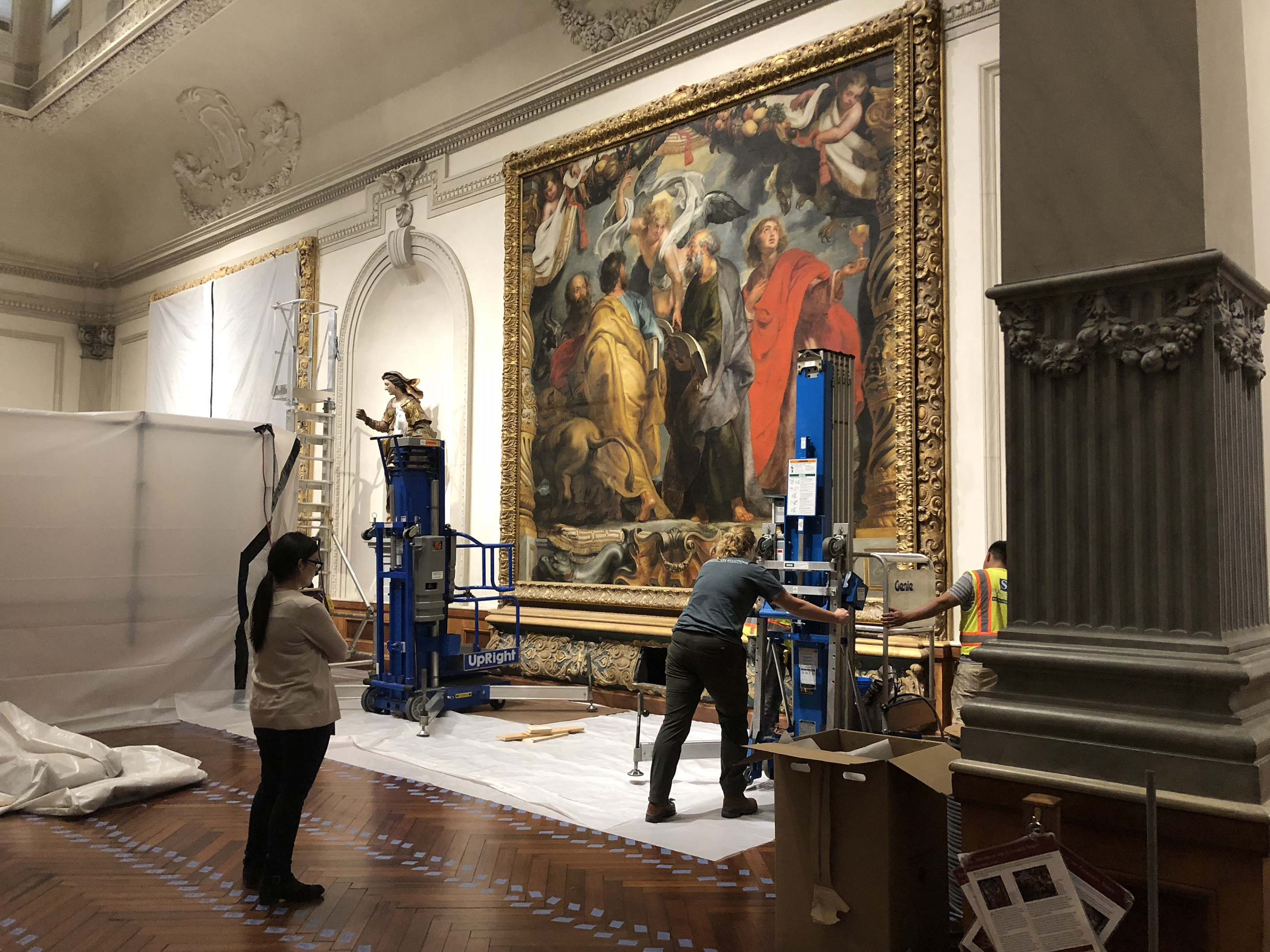 Conservators cover paintings by Peter Paul Rubens before restoring the historic floor in The John and Mable Ringling Museum of Art
