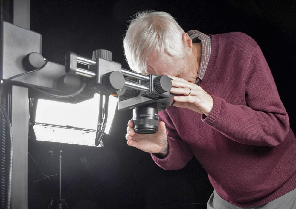 An archivist photographs material in The Archives Digilab