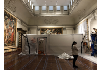 Conservator in front of temporary tent in Gallery 2 of The John and Mable Ringling Museum of Art during conservation of the historic floor